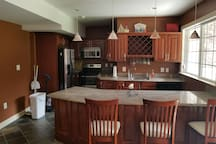 Full Private kitchen with granite tops stainless steel appliances