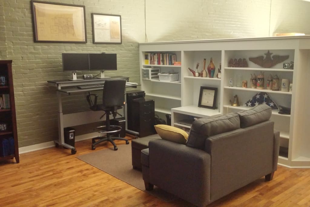Separate work space with love seat and computer access.