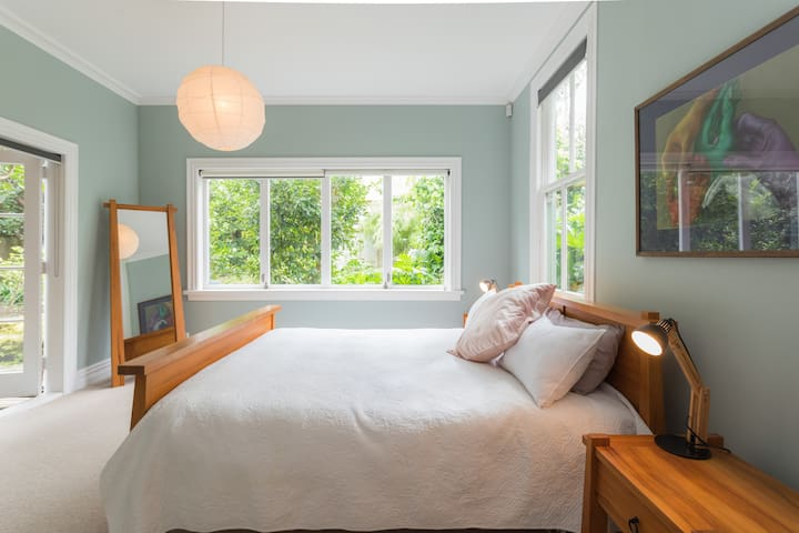 Master bedroom with comfy king size bed and garden views