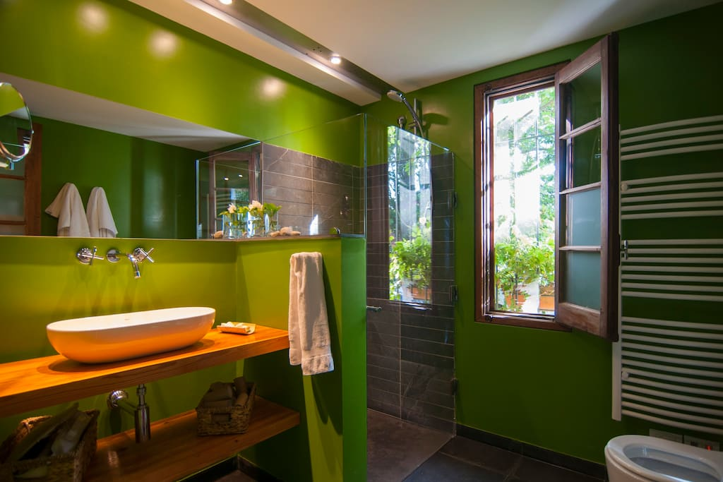 The bathroom has its original wooden window and doors combined with a contemporary design.