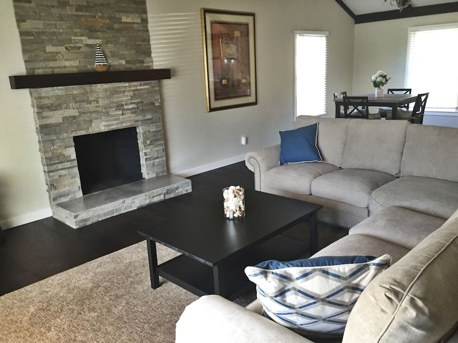 Custom built fireplace highlights the open living room space.