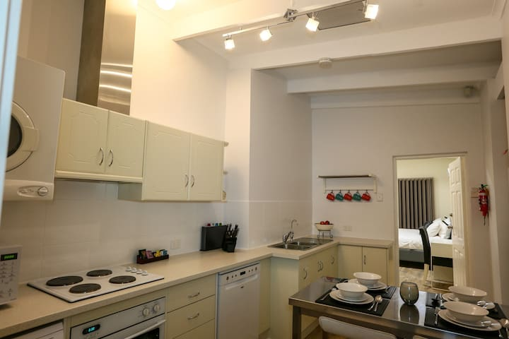 Fully decked out kitchen with dishwasher, microwave, oven. Electric rice maker, sandwich maker and pod coffee also in the kitchen.
