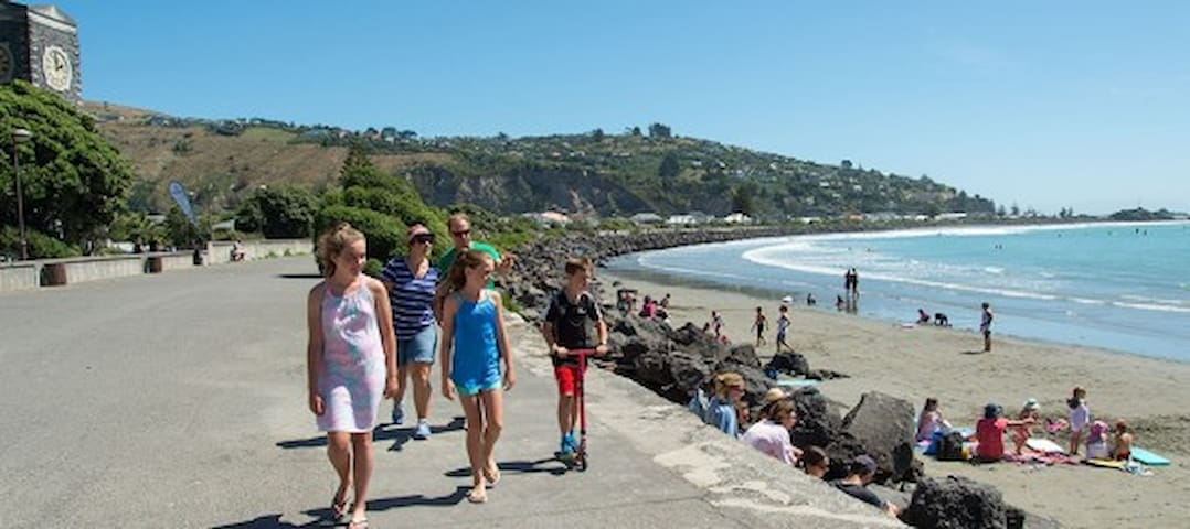 Sumner Beach - swimming, surfing and cafes