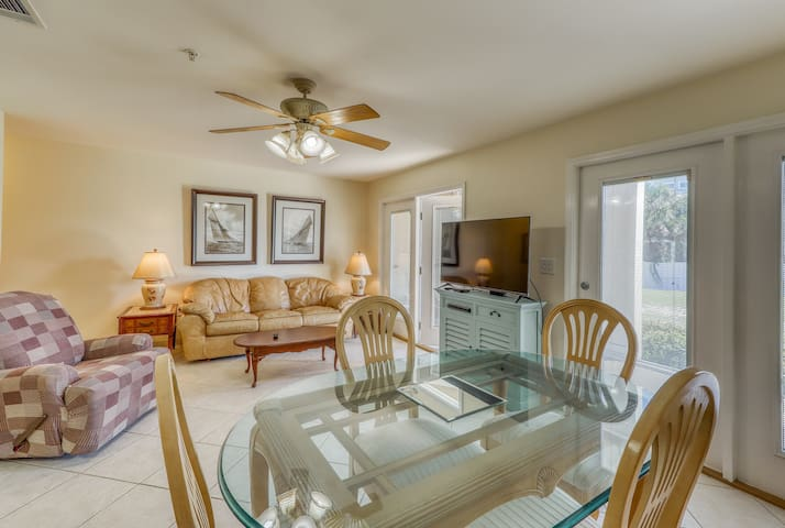 NEW LISTING! Charming condo with a private deck and  shared swimming pool