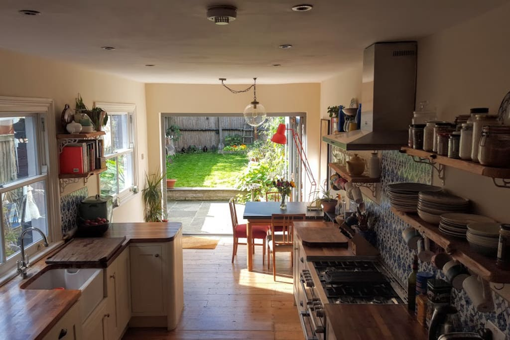 Eat-in kitchen with glass doors to garden