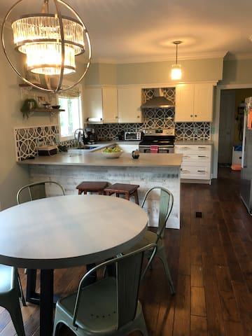 kitchen with breakfast table and bar stools