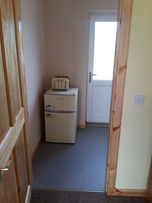 Entrance hall with fridge freezer