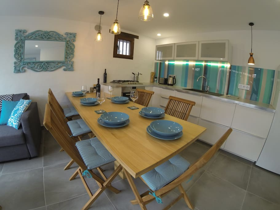 Modern open-plan kitchen with all the latest appliances: SMEG gas hob, SIEMENS oven, perfect space for cooking. LED mood lighting. Large dining table/breakfast bar to seat 6 persons.