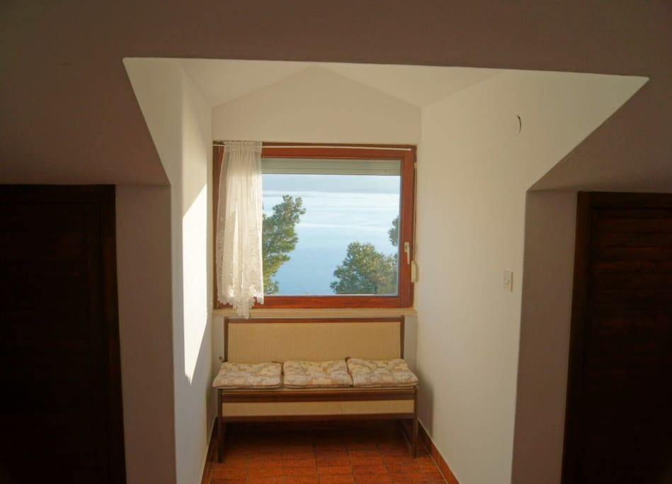 Big window with a view over the Adriatic sea and island of Brač