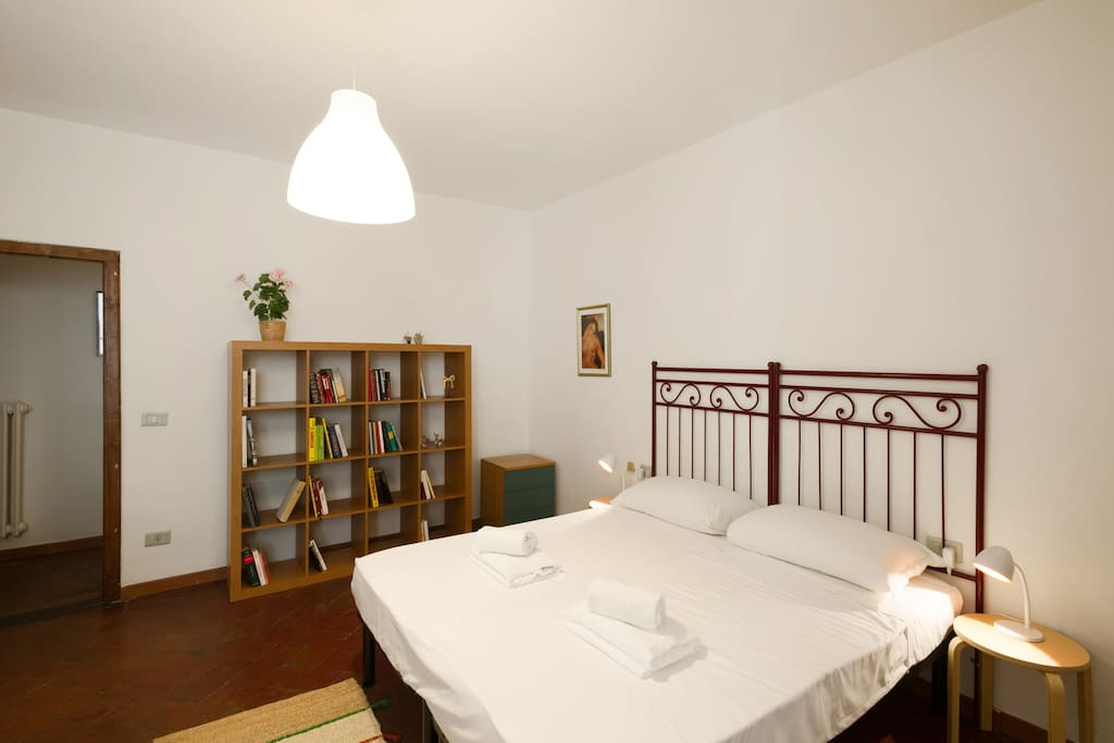 The Bedroom - Two single beds with soft bed-linen and towels