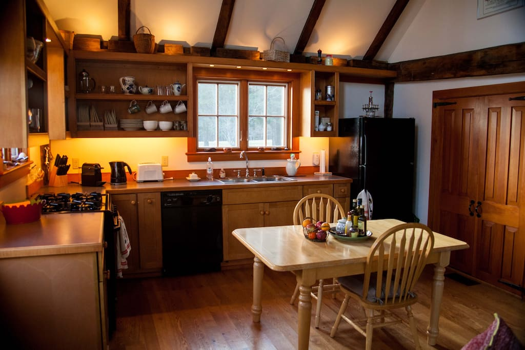 The expandable kitchen table can accommodate six for a meal.  There are a gas range/oven for baking, a Nespresso coffee maker,( and press pot) toaster, and a microwave oven ( behind pantry doors). The kitchen is fully equipped with pots and pans, dishes, silver, glasses etc.