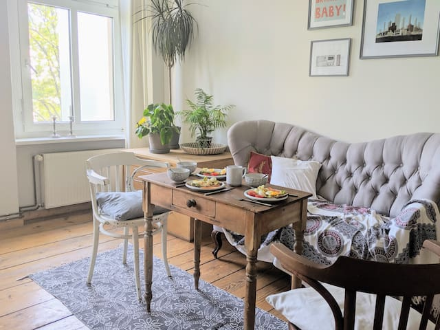 The living room faces a quiet bright courtyard. It has a cozy seating area and all my books. Feel free to browse.