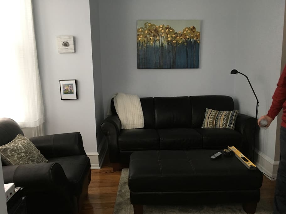 Sitting room off the bedroom, bright spot with couch and tv.