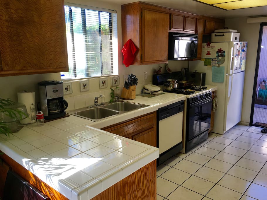 Shared kitchen equipped with microwave, oven, stove, refrigerator, coffee maker and all cooking utensils.
