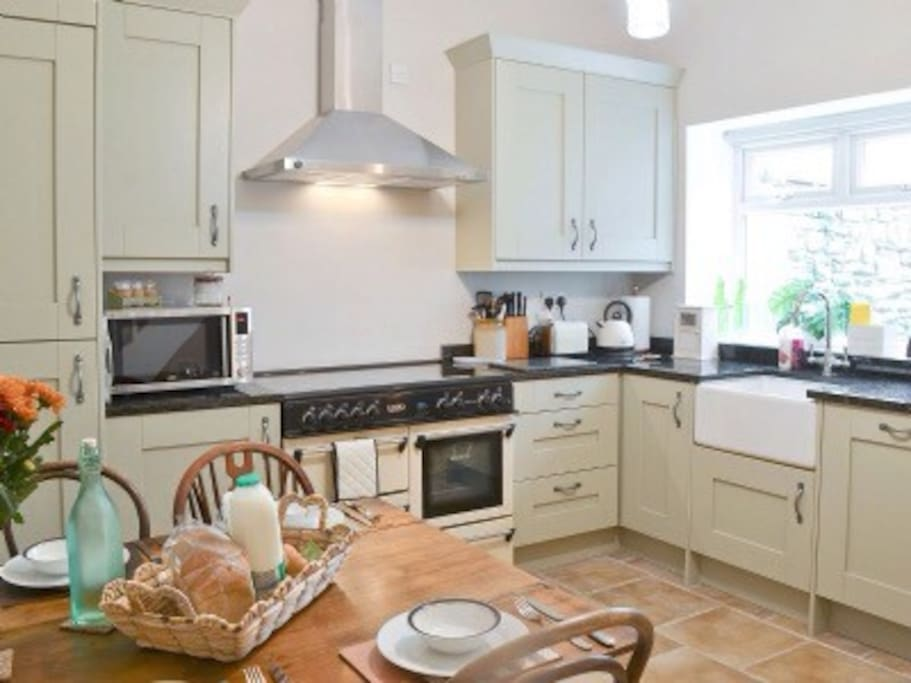 fully equipped kitchen including fridge freezer, micro wave, dishwasher and range cooker