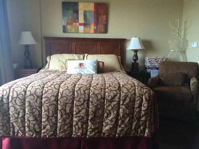 Comfy queen bed and reading chair