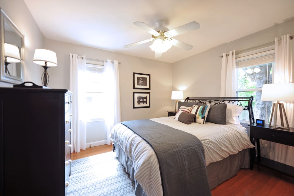 The master bedroom  is spacious and has plenty of natural light.