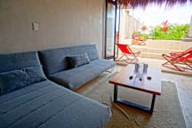 Lounge area opening to your private rooftop patio and jacuzzi