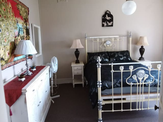 Bedroom 1. Antique queen bed with king size doona. Electric blankets and fans. Very large rooms with double glazing