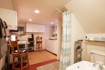 The kitchenette, laundry and bath are all together.  Very Ikea, very clean.