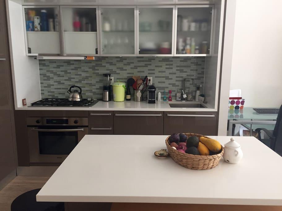 Open plan kitchen w/dishwasher and Italian marble finishings