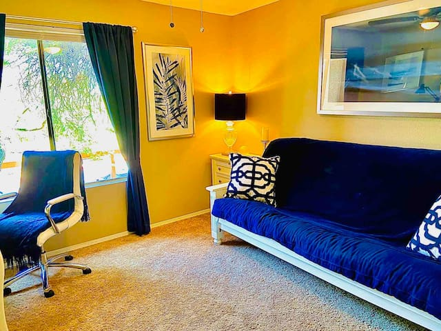 This blue futon in the guest bedroom/office can fold down into a comfortable bed. There is a ceiling fan in this room in addition to central air conditioning as well.