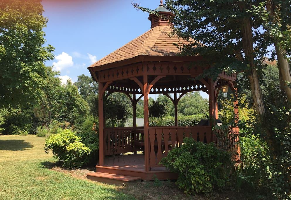 Gazebo with sitting area overlooking the backyard. This is a great neighborhood for your morning walk  or run.