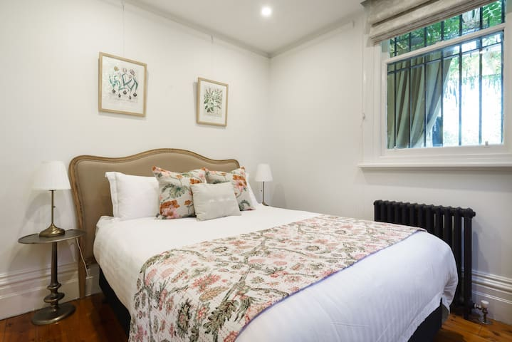 The second bedroom offers a very comfortable queen bed in a delightful botanical theme.
