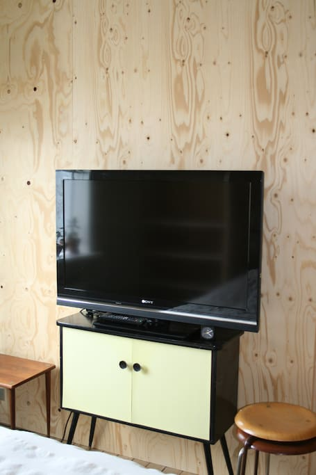 Tv in the sleeping room has several ways and plugs to connect to laptops to stream a good movie
