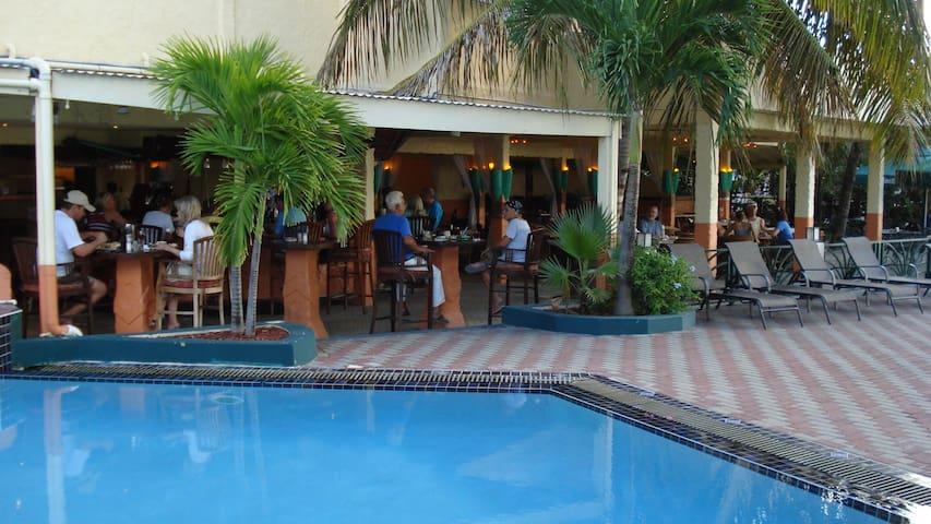 Atrium's pool with adjacent restaurant & Beach bar