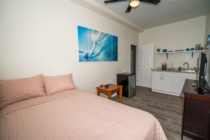 Room 8 with full size bed, AC & wet-bar