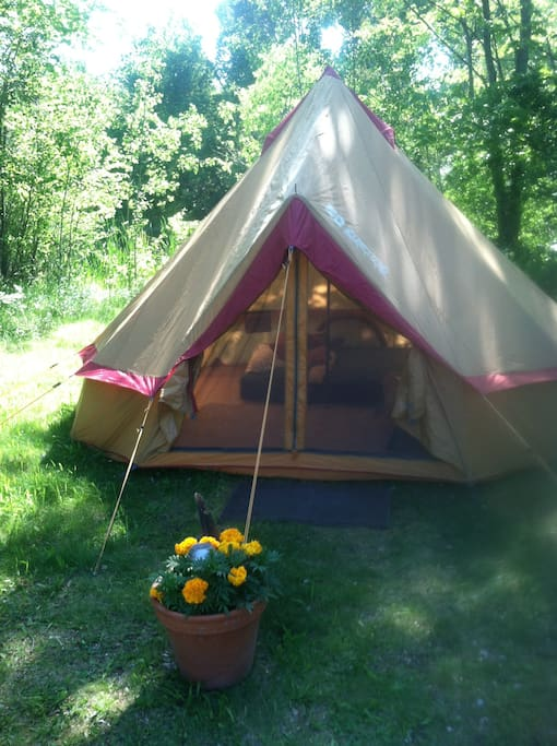 Yurt Tent is furnished with fresh sheets, blankets and towels. There is a chair and small desk as well.