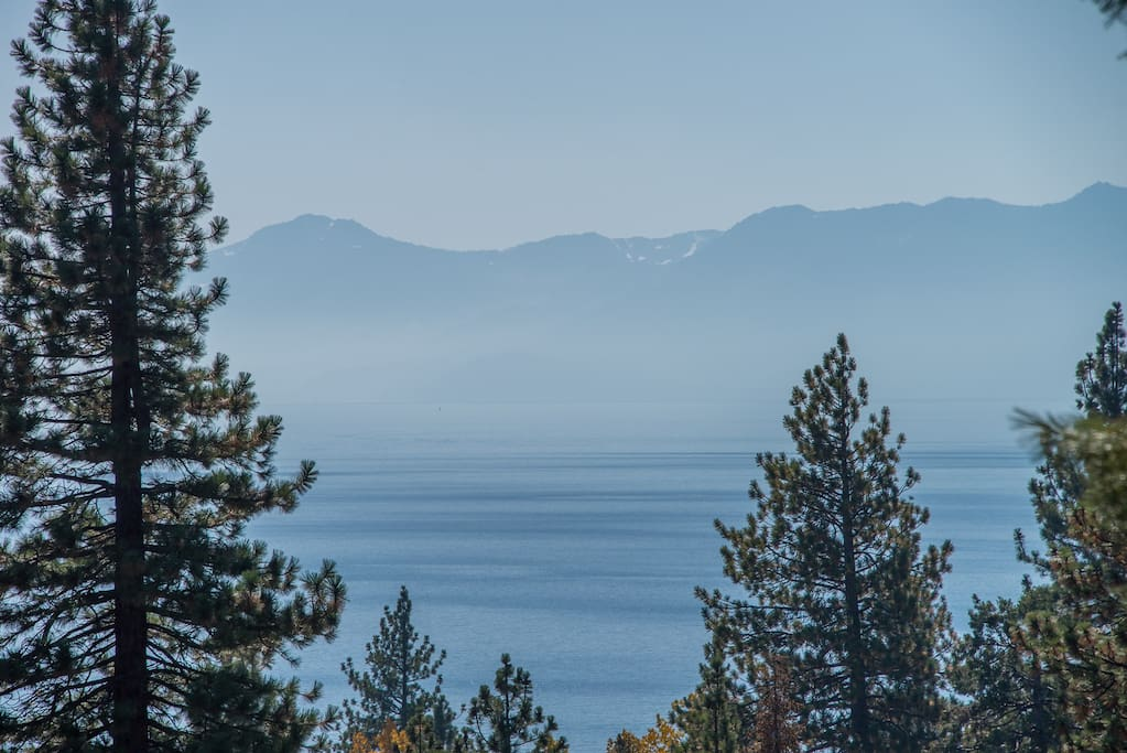 Large back deck with views of Lake Tahoe and private hot tub.