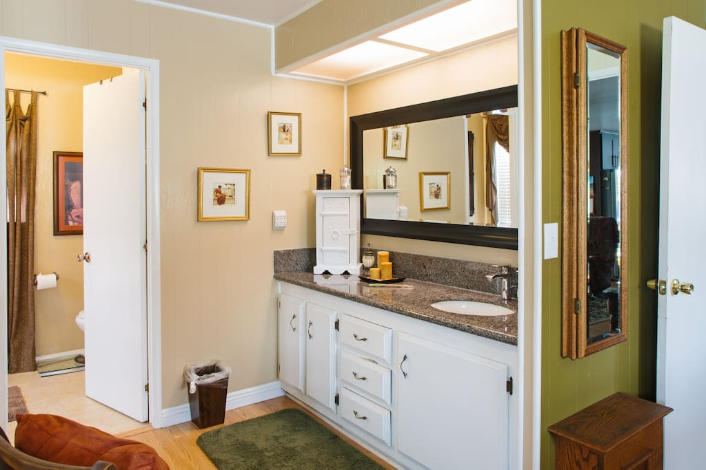 Attached bath with large mirrored closet doors