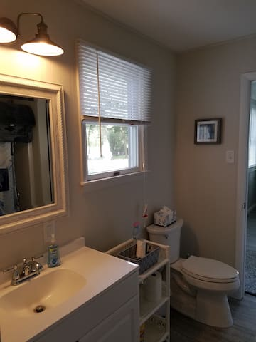Newly remodeled bathroom with tub and shower.