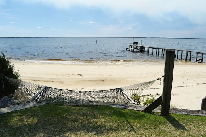 Common areas have charming river beach access.