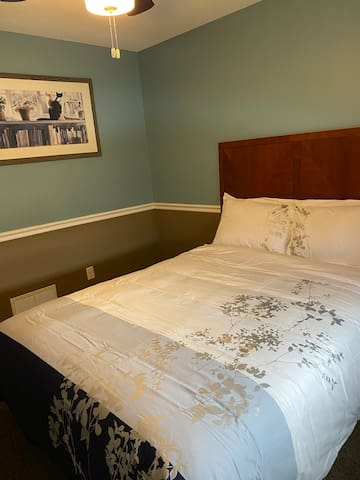 Queen bed decor In Blue and tan