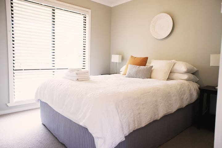 Second bed room with comfortable queen size ensemble, bedside tables and lamps, electric blanket and built in robe