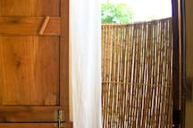 Garden Room is a round room with a round bamboo ensuite bathroom.