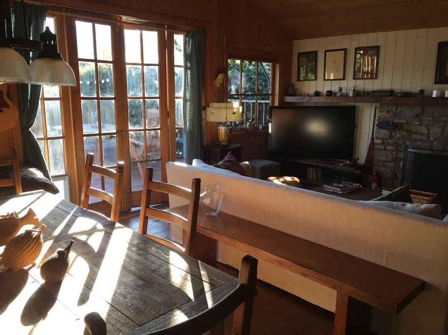 Newly Remodled living room with french doors leading out to recently rebuilt Indonesian hardwood deck