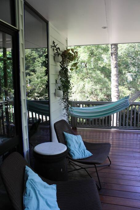 Relax on a chair or  hammock looking out to the tree ferns and the palm trees