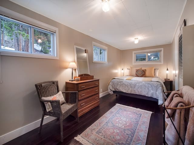 Bedroom with new queen size bed and plenty of cozy liens and pillows