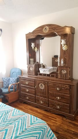 dresser with full mirror in your bedroom, rocking chair with ottoman