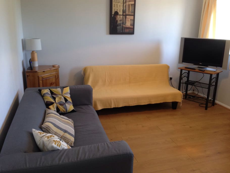 Lounge diner: comfortable sofa plus sofa bed (with the yellow throw on ); tv with freeview; and wifi.