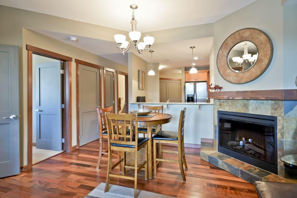 Beautiful hardwood flooring and trim, cozy fireplace too