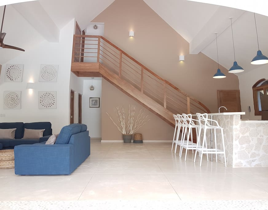 Huge 8 meters (26 feet) high living space with wood stairs