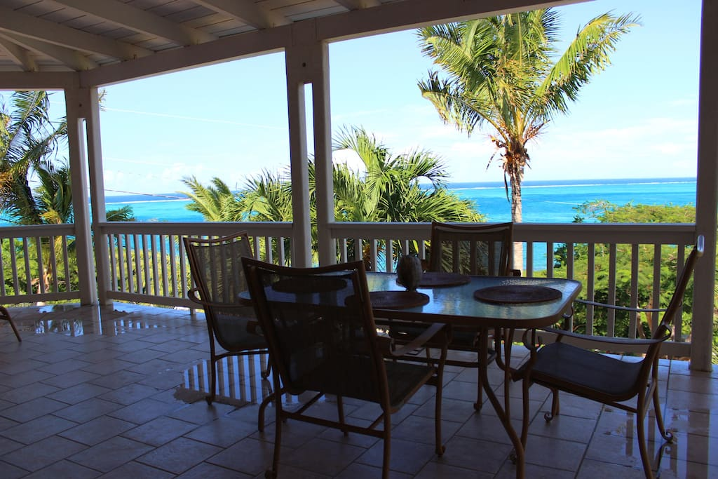 Views from the expansive deck with outdoor dining and 2 lounge chairs