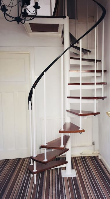 Guests private hallway with spiral staircase to bedroom; for your use only.