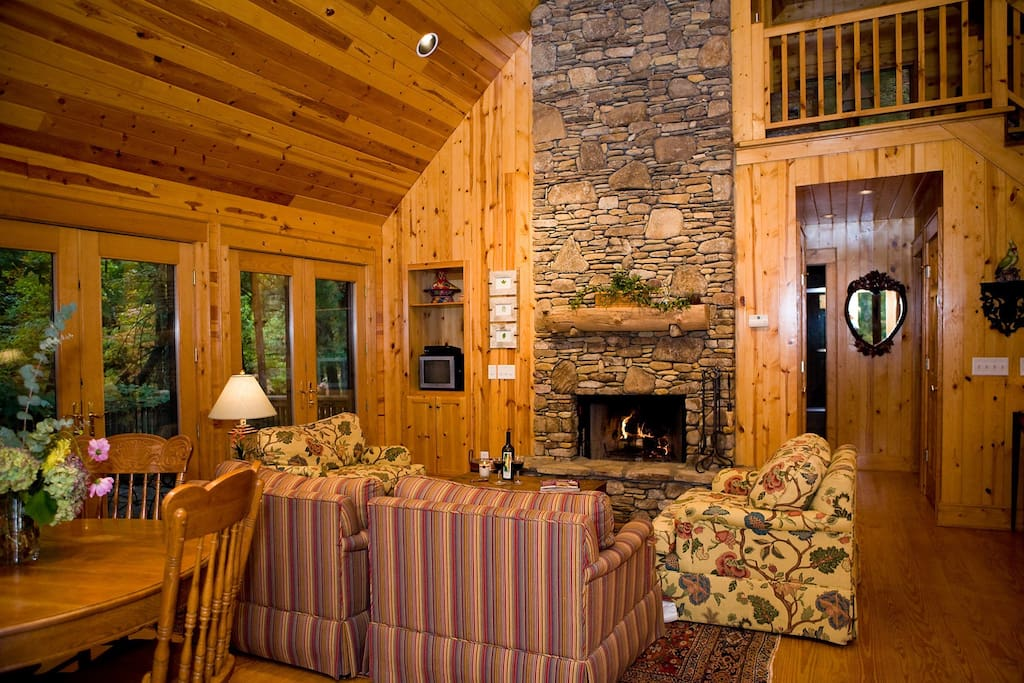 Living space with fireplace and vaulted ceiling