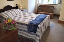 Our south facing Abbot's Room, has a double bed can also have an extra single bed if needed